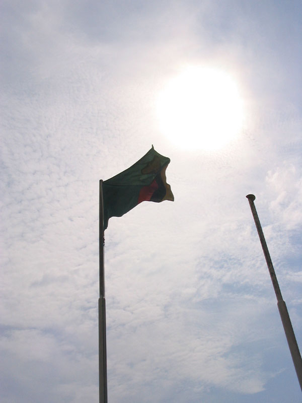 The Zambian flag flies at